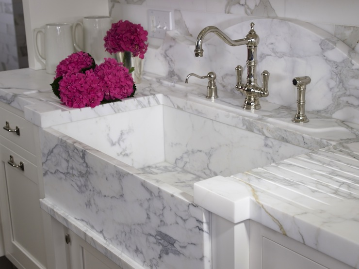 Natural stone sinks amanzi marble granite though costly and requiring reinforced construction to hold this heavy material safely in place a natural stone kitchen sink workwithnaturefo